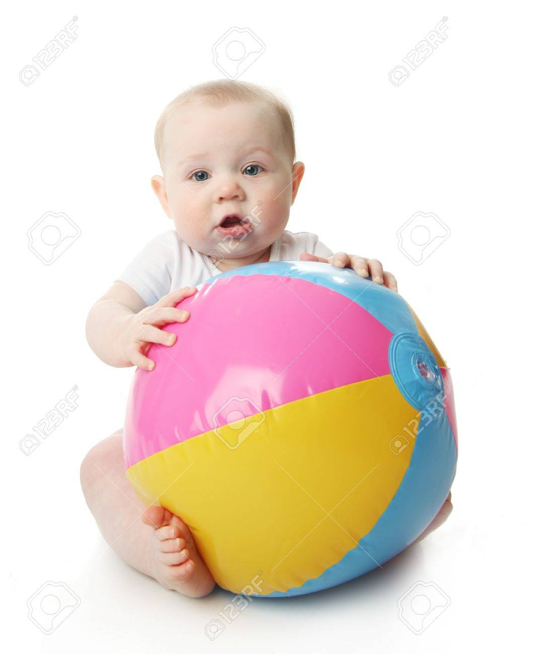 Adorable baby playing with a colorful beach ball, isolated on white - 9939533
