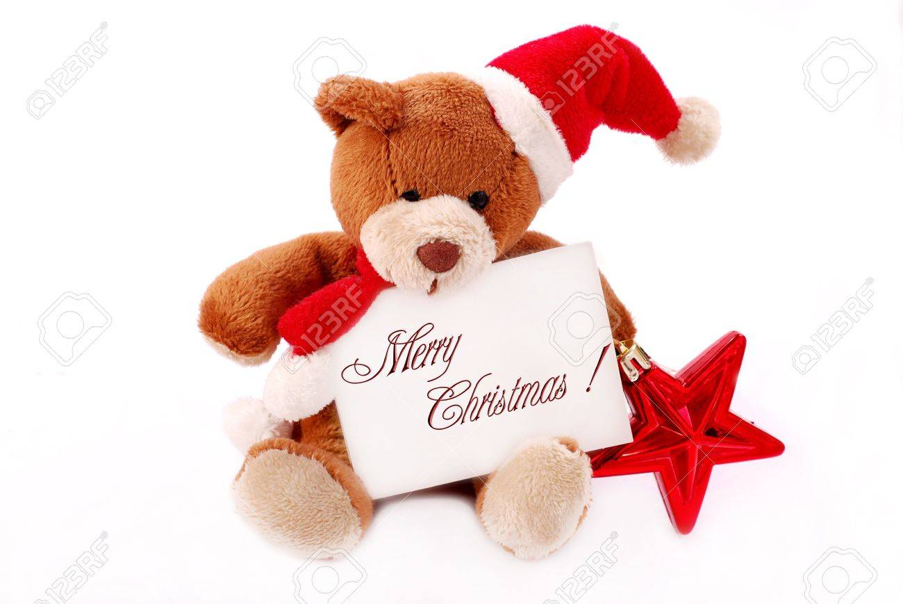 Christmas Wishes Bear.Little Teddy Bear Holding Card With Christmas Wishes