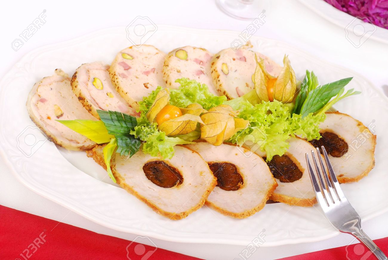 platter with sliced loin of pork stuffed with plum and galantine with pistachios Stock Photo - 7141828