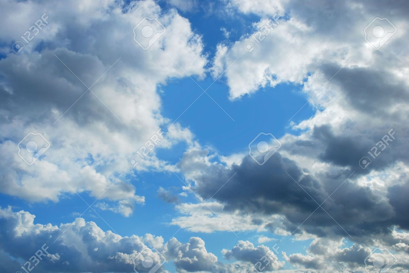cloudy sky with heart shape blue hole stock photo, picture and