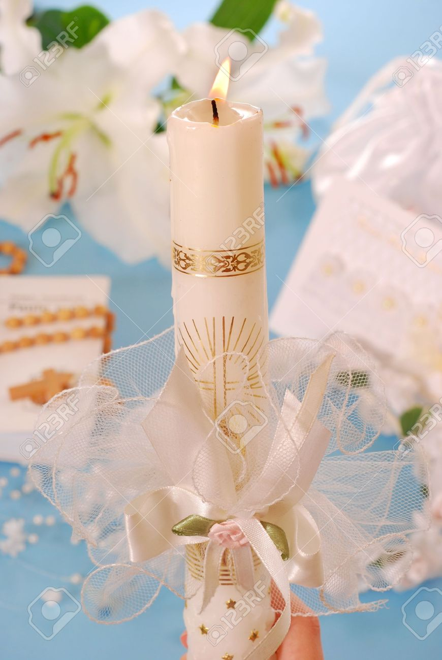 white candle with decoration for first holy communion on blue background Stock Photo - 9269292