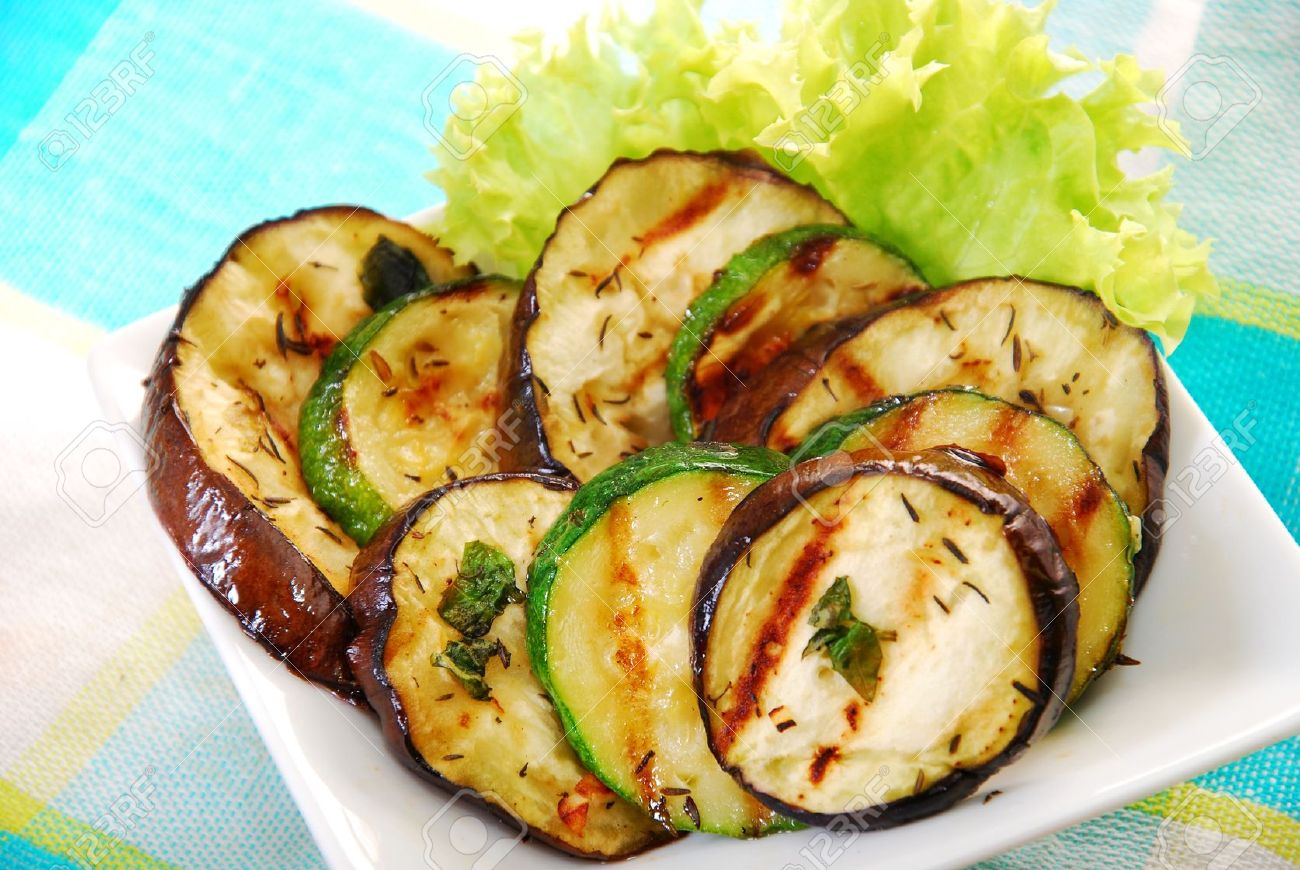 salad with grilled aubergine and zucchini marinated in oil and herbs - 15710393