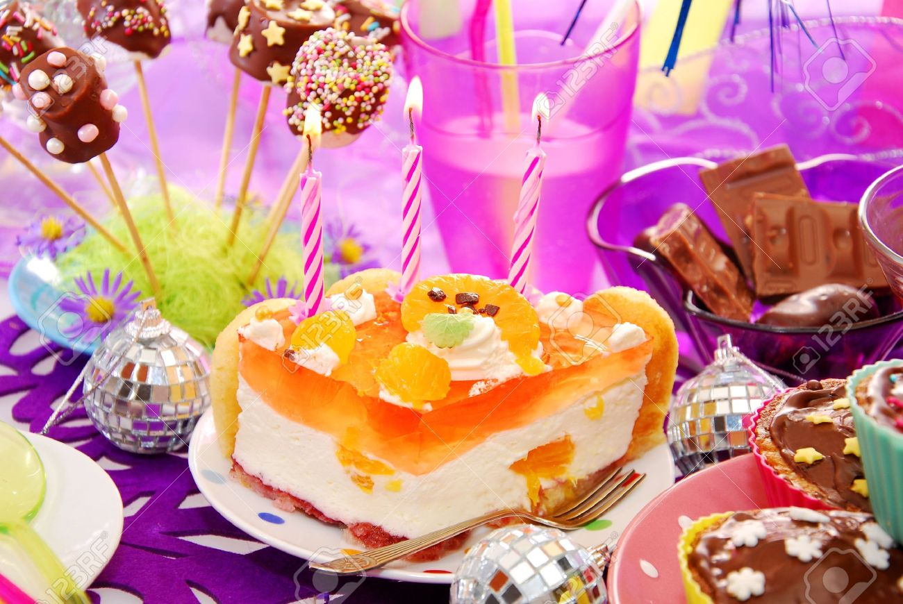 colorful decoration of birthday party table with cake and sweets for child - 15821920