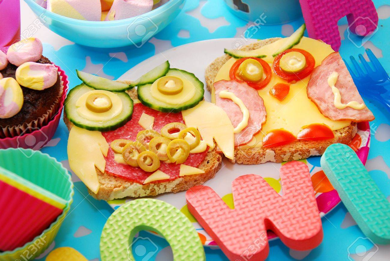 funny sandwiches with owl made from cheese ,sausage and vegetables for child - 16572669