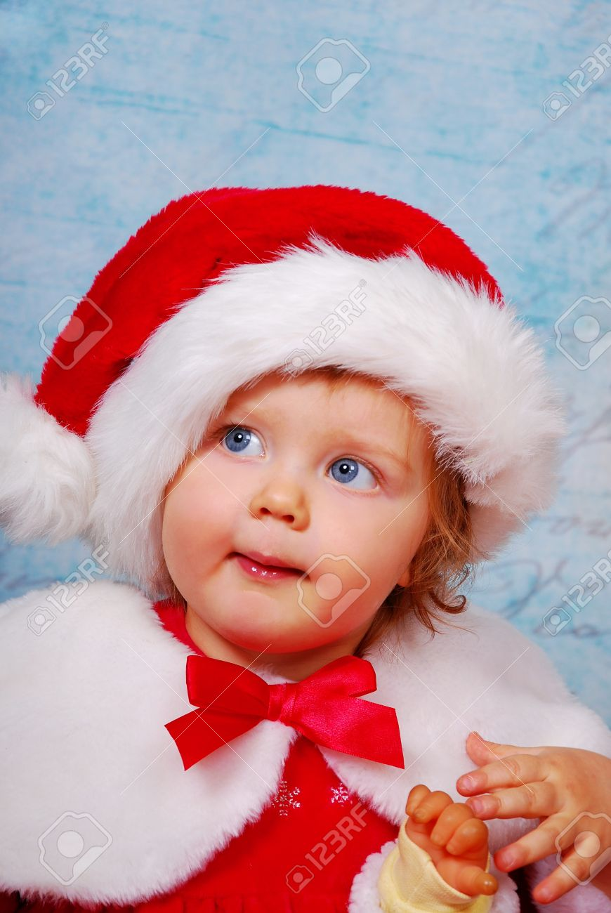 115616107 portrait of cute baby girl in red santa hat and dress Stock Photo - 16828067