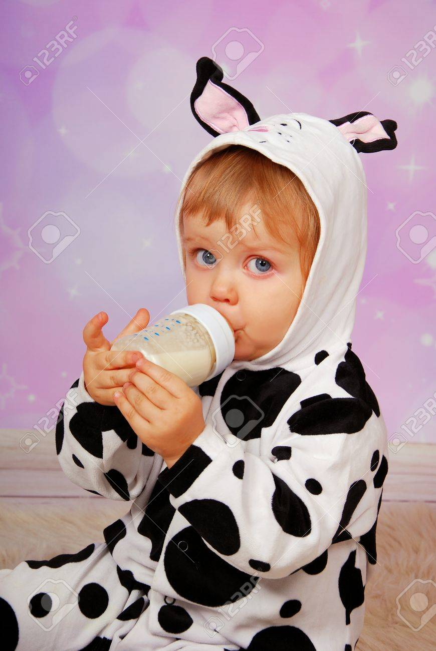 little baby girl in cow costume drinking milk from bottle Stock Photo - 16904069 & Little Baby Girl In Cow Costume Drinking Milk From Bottle Stock ...