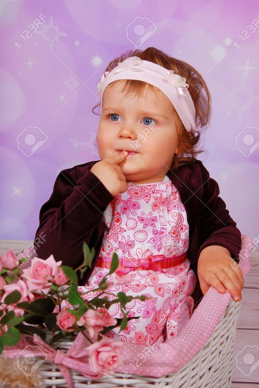 342efb2e4 Cute Baby Girl Sitting In White Wicker Basket Stock Photo