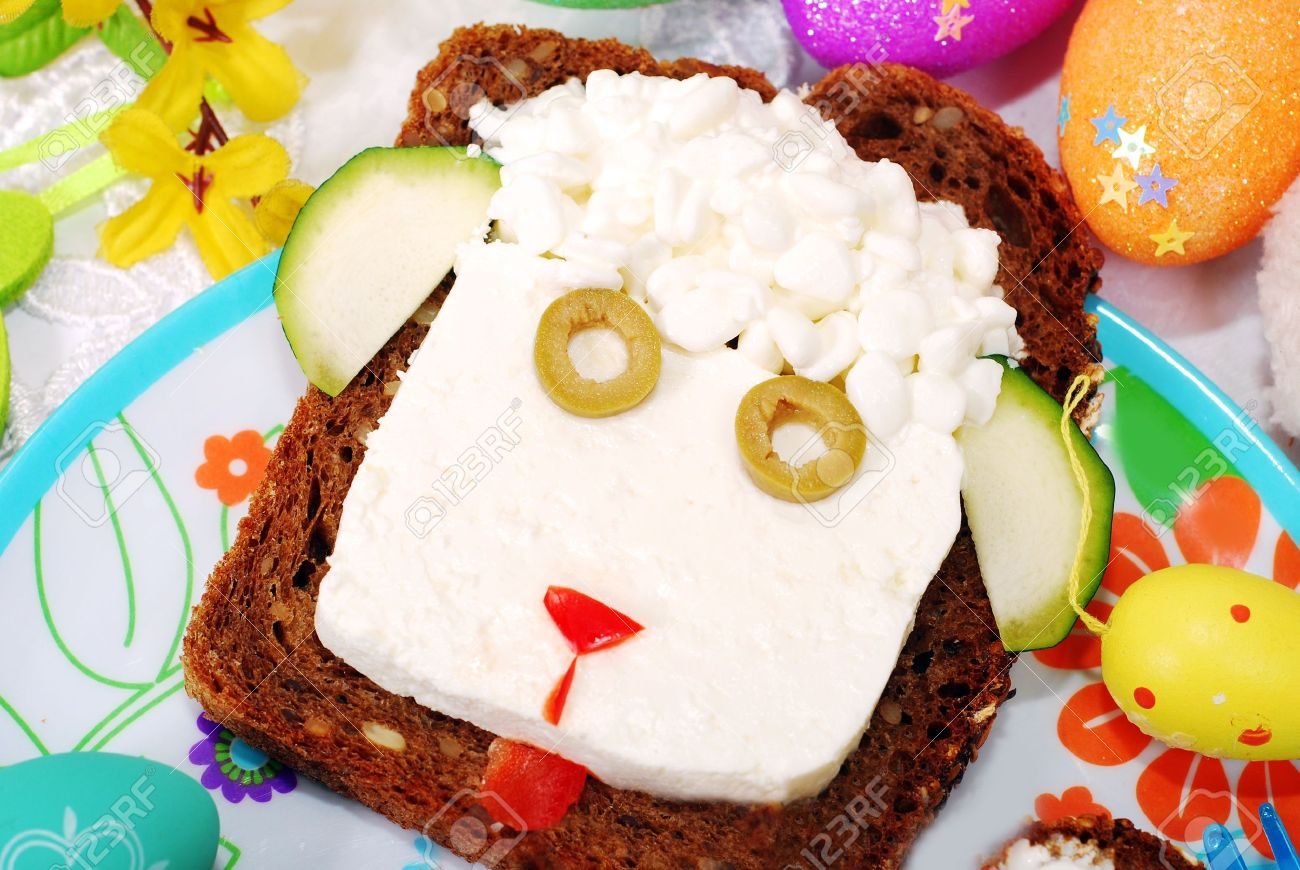 funny easter sandwich with sheep head made from cottage cheese on dark bread as breakfast for child - 18289287