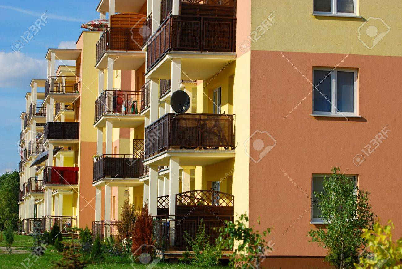 newly inhabited yellow block of flats and apartments - 20939647