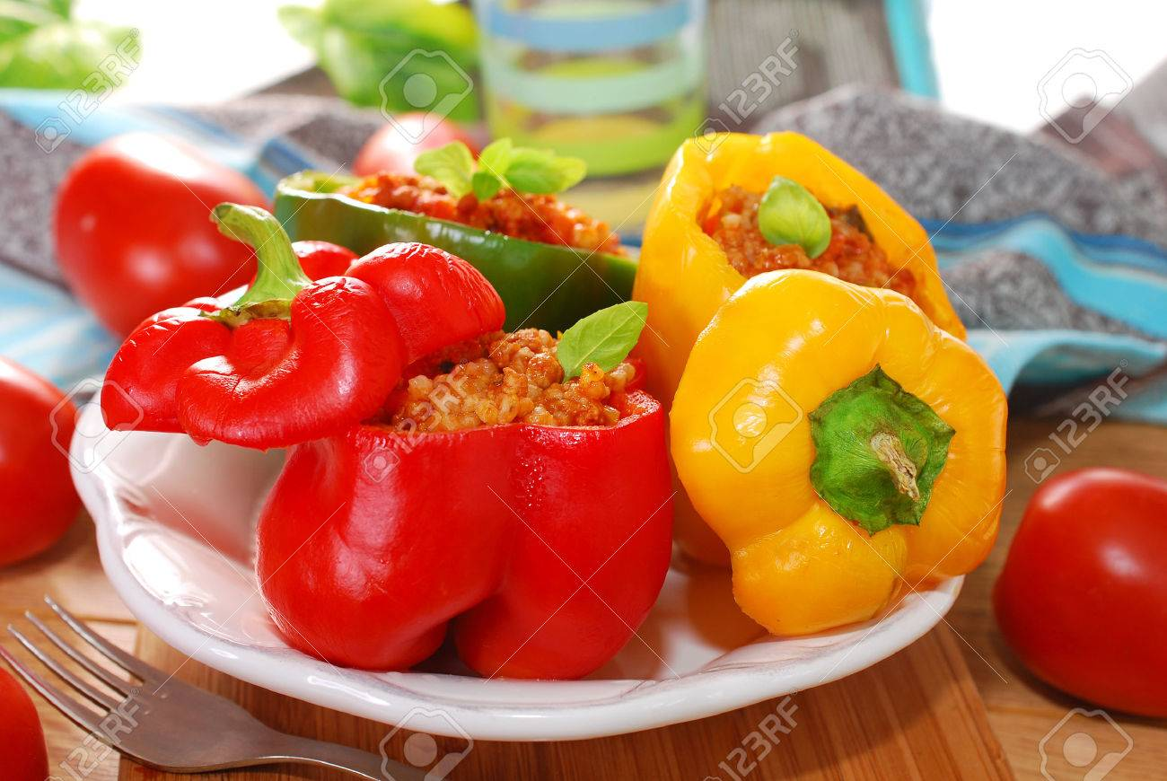 three color bell peppers baked and stuffed with minced meat and vegetables - 22577772