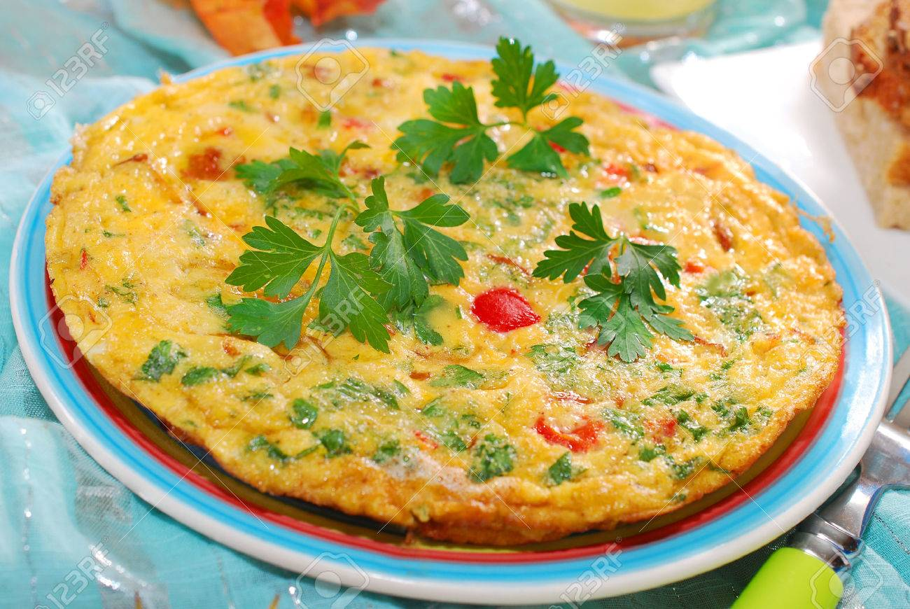 frittata with chanterelle,onion,red pepper and parsley for autumn breakfast or lunch - 22577791