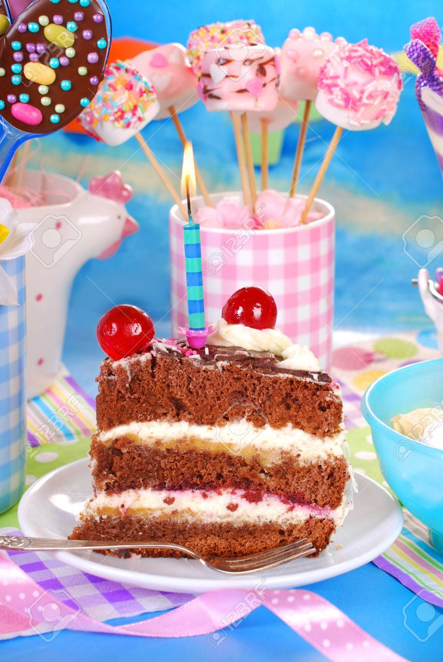 Slice Of Chocolate Birthday Cake With One Candle On Festive Table