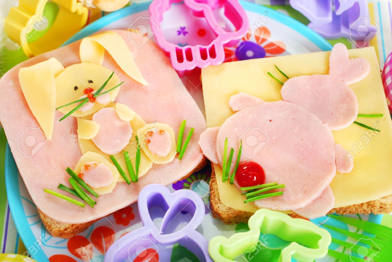easter sandwiches with funny bunny made from ham,cheese and chives for kids - 26511700
