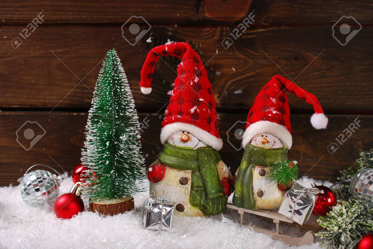 Christmas Decoration With Two Funny Santa Claus Figurines On Wooden Background Stock Photo 33885725