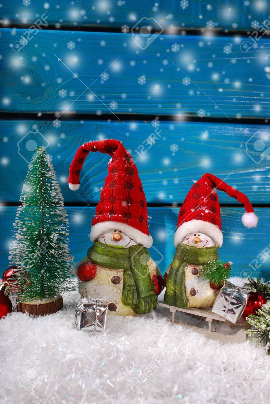 Christmas Decoration With Two Funny Santa Claus Figurines On Blue Wooden Background Stock Photo 33885730