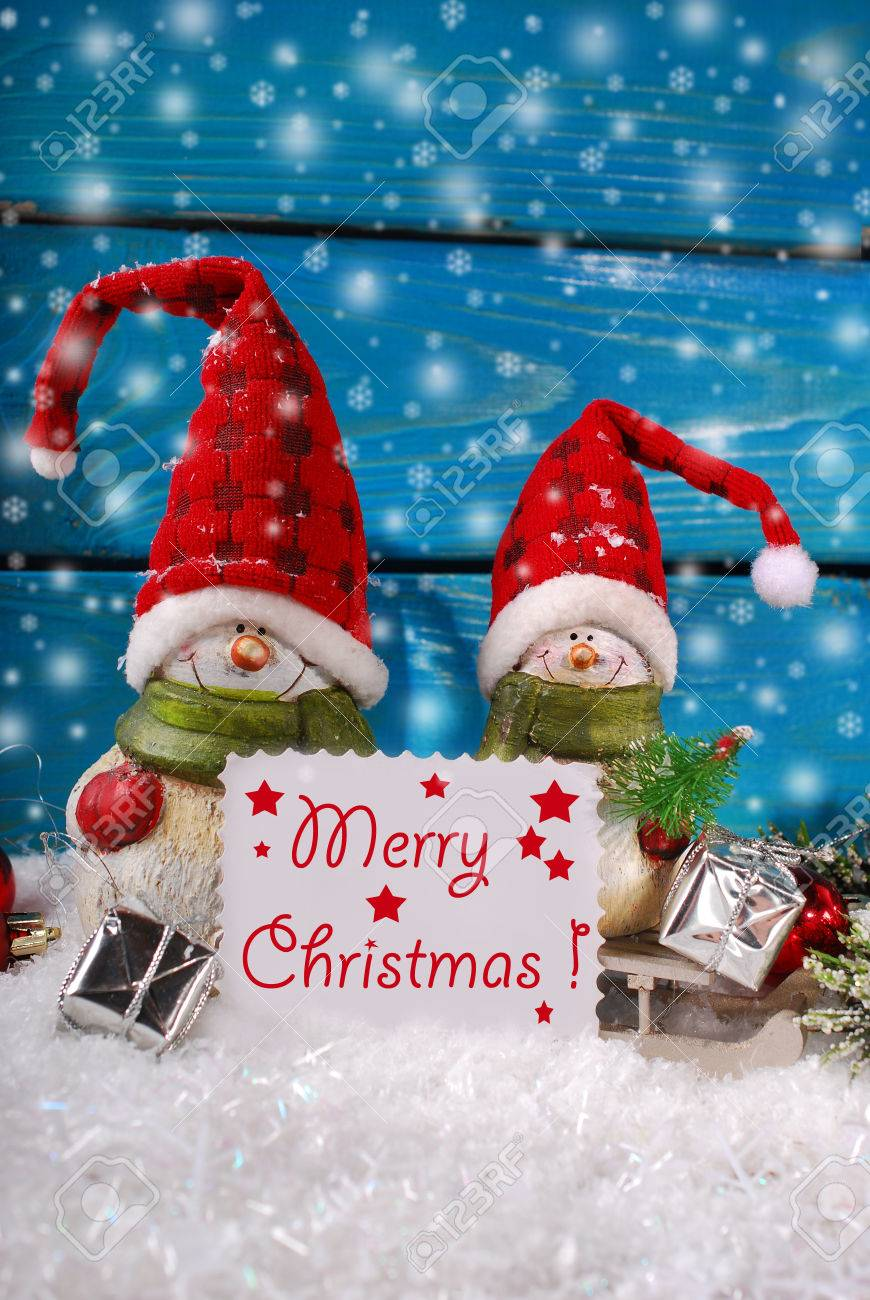 Christmas Decoration With Two Funny Santa Claus Figurines On Blue Wooden Background Stock Photo 33885764