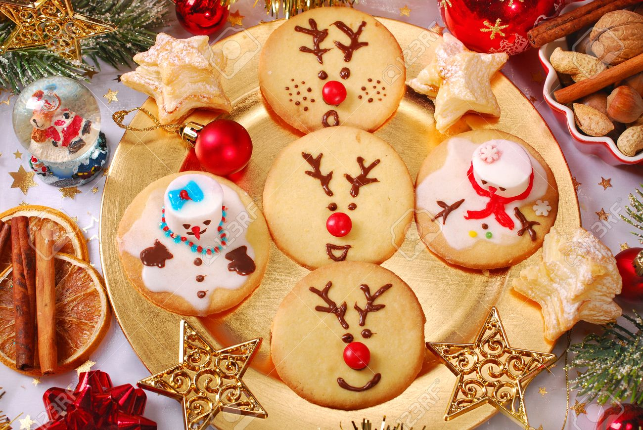 Funny Snowman And Reindeer Shaped Christmas Cookies Made By Kids ...