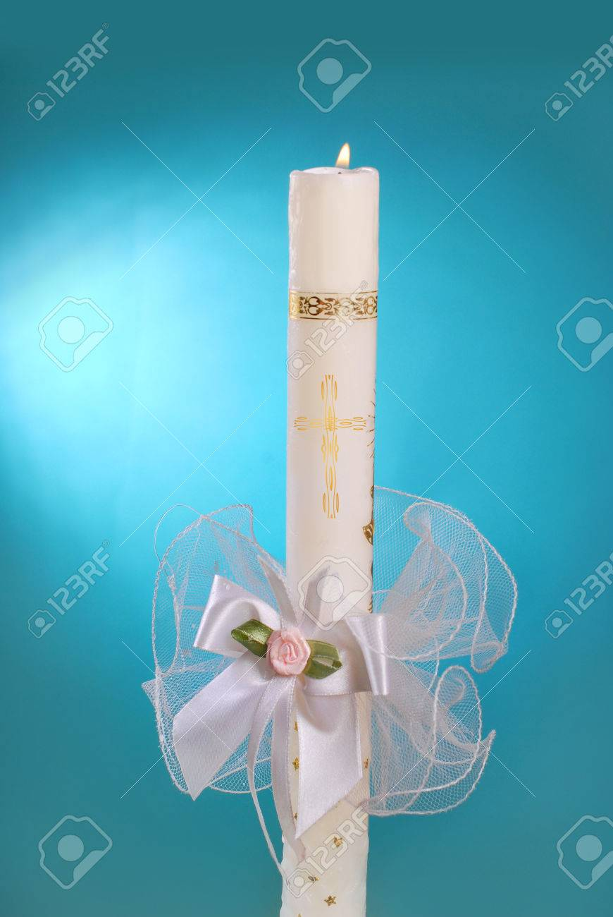 White Candle For The First Holy Communion On Blue Background Stock ... for Blue Candle White Background  143gtk