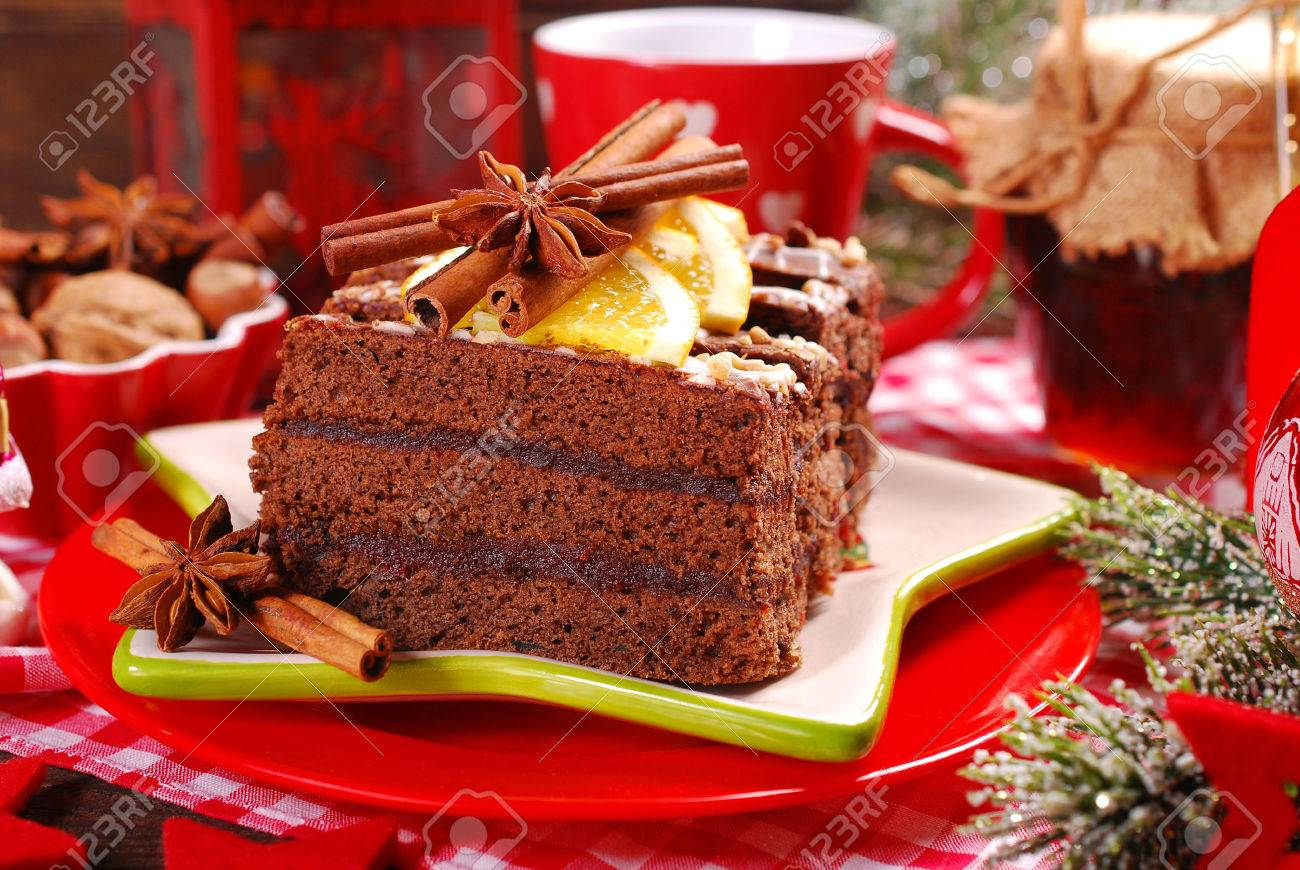 homemade gingerbread cake with plum confiture and chocolate glaze for christmas dessert - 49124916