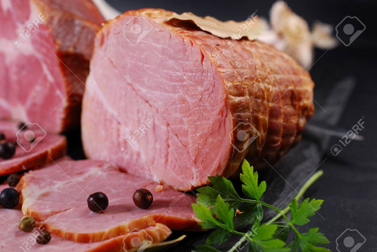 pieces of delicious homemade smoked pork ham with spices on black background - 51399824