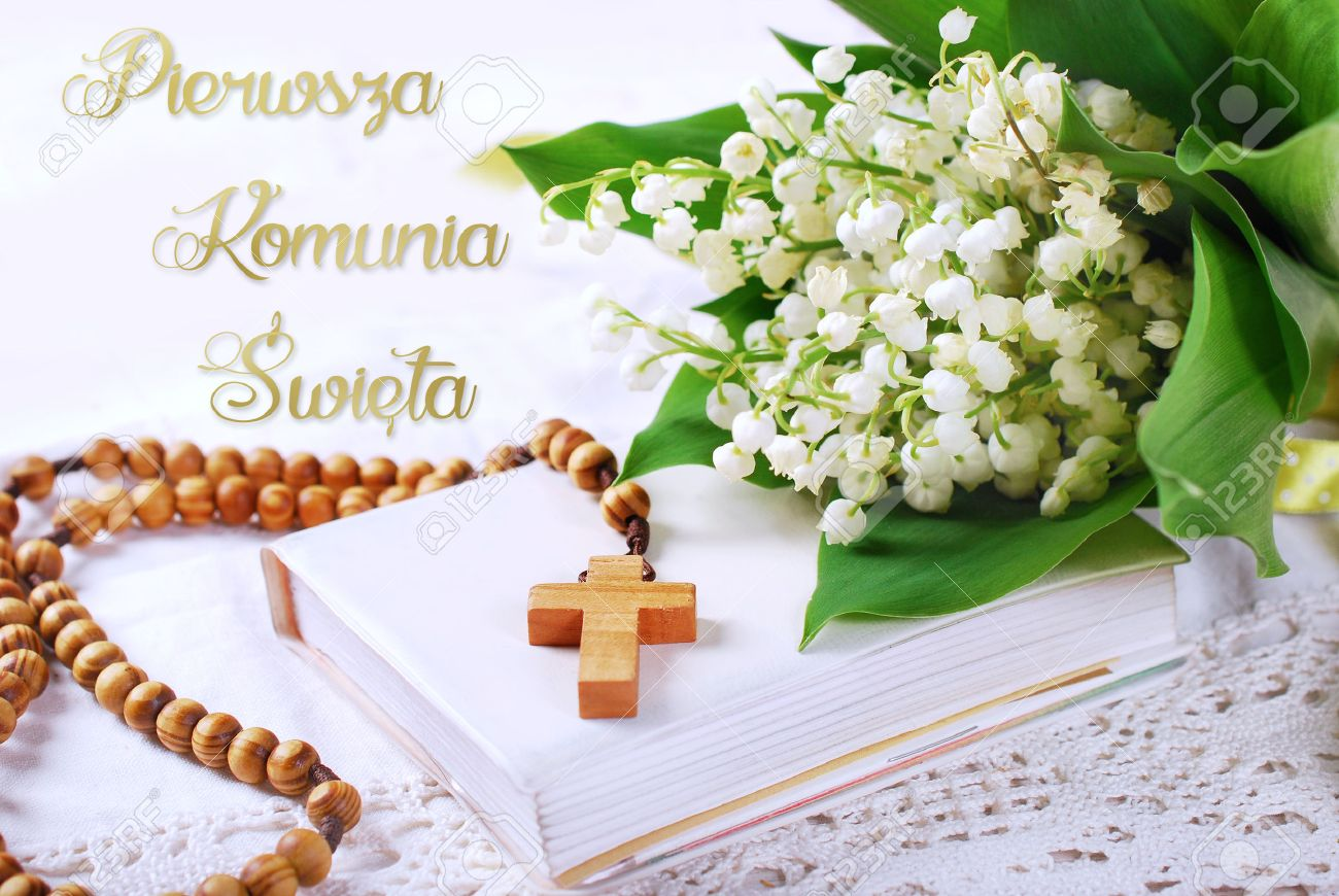 The first holy communion with wooden rosaryprayer book and stock stock photo the first holy communion with wooden rosaryprayer book and bunch of lily of the valley polish language version izmirmasajfo