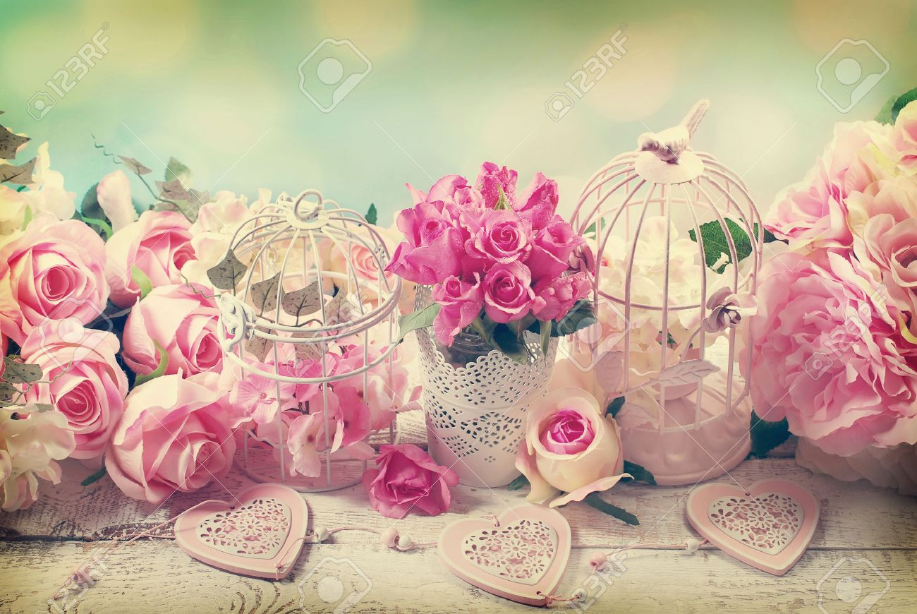 romantic vintage love background with bunches of roses, old cages and hearts - 57802139