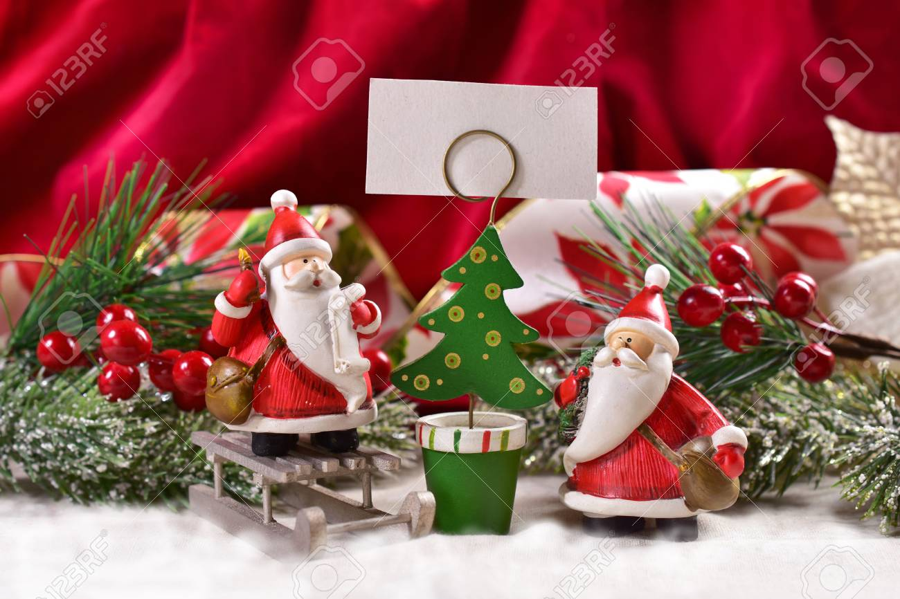 Christmas Decoration With Two Funny Santa Clauses Figurine And Christmas Tree Shape Card Holder For Greetings