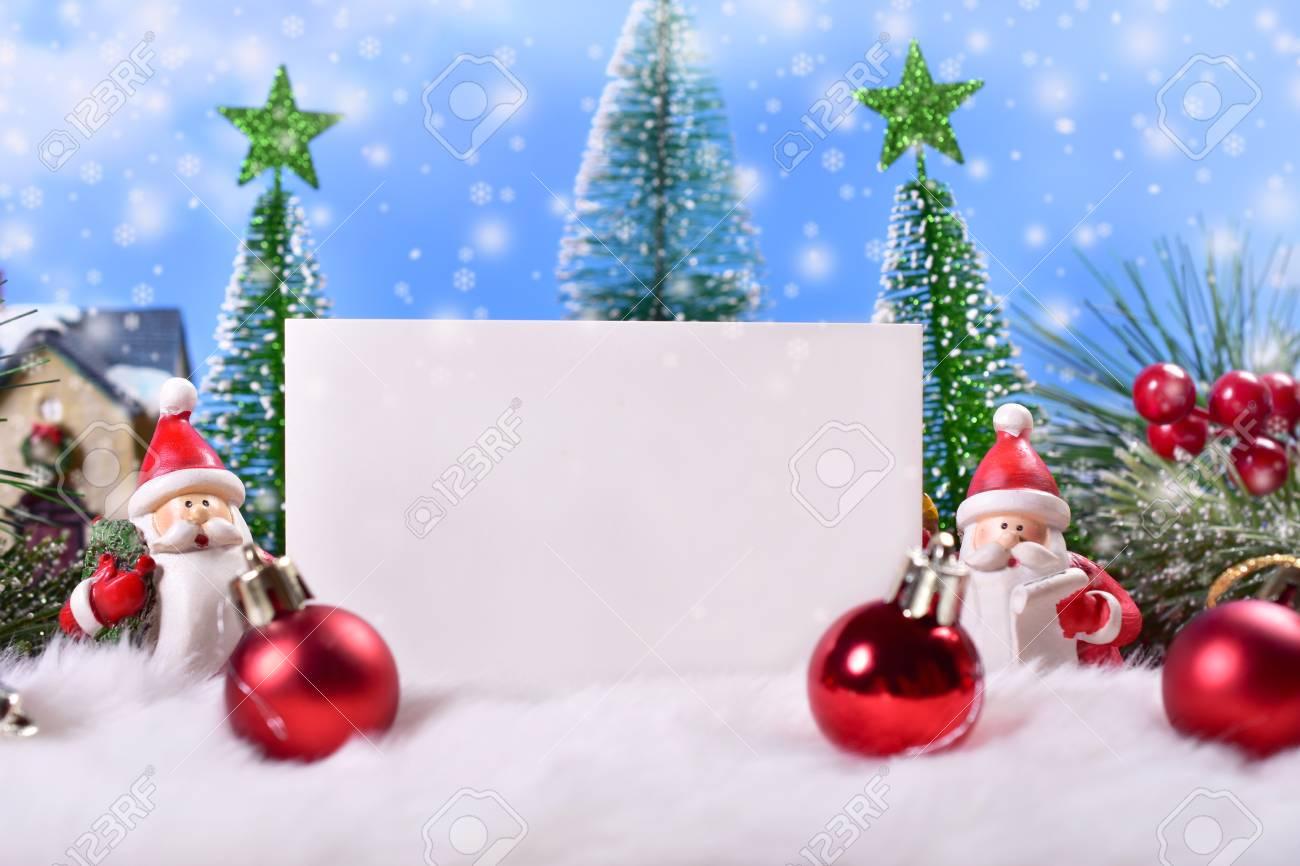 Beautiful Christmas Greeting Card With Santa Clauses Figurine