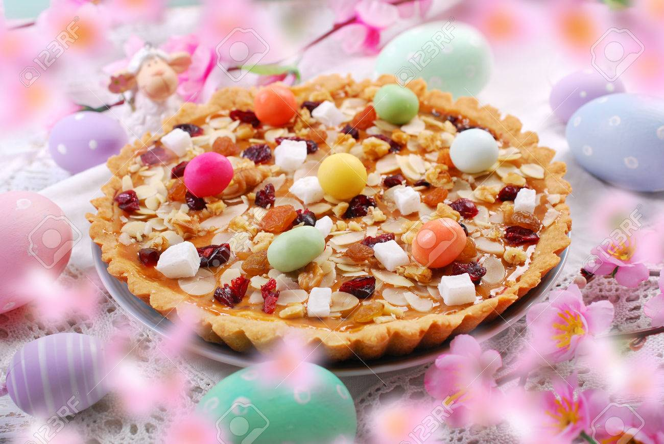 traditional polish easter butterscotch cake called mazurek with caramel layer,nuts and dried fruits - 71896462