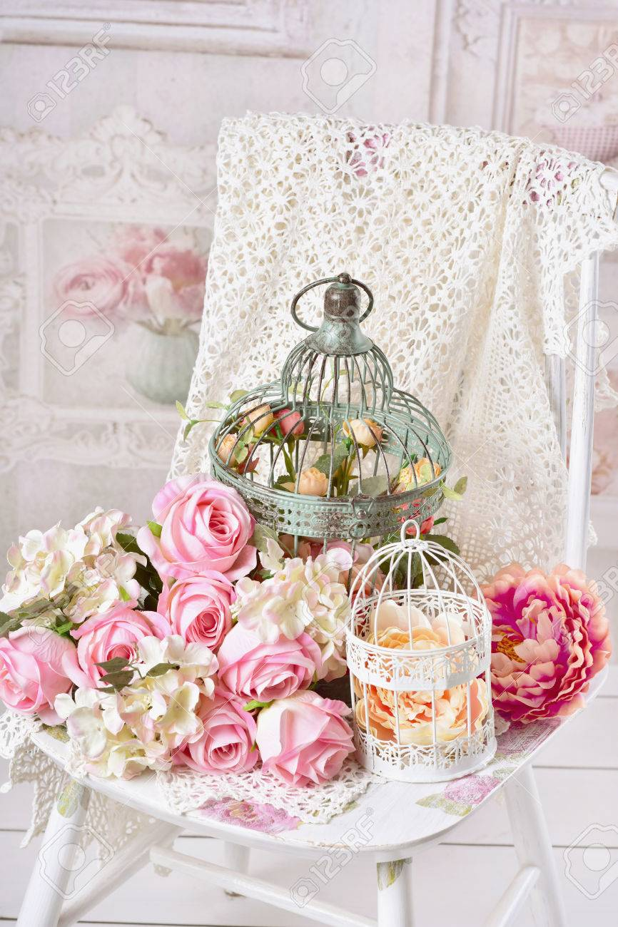 Vintage Style Decoration With Flowers In Old Metal Bird Cages