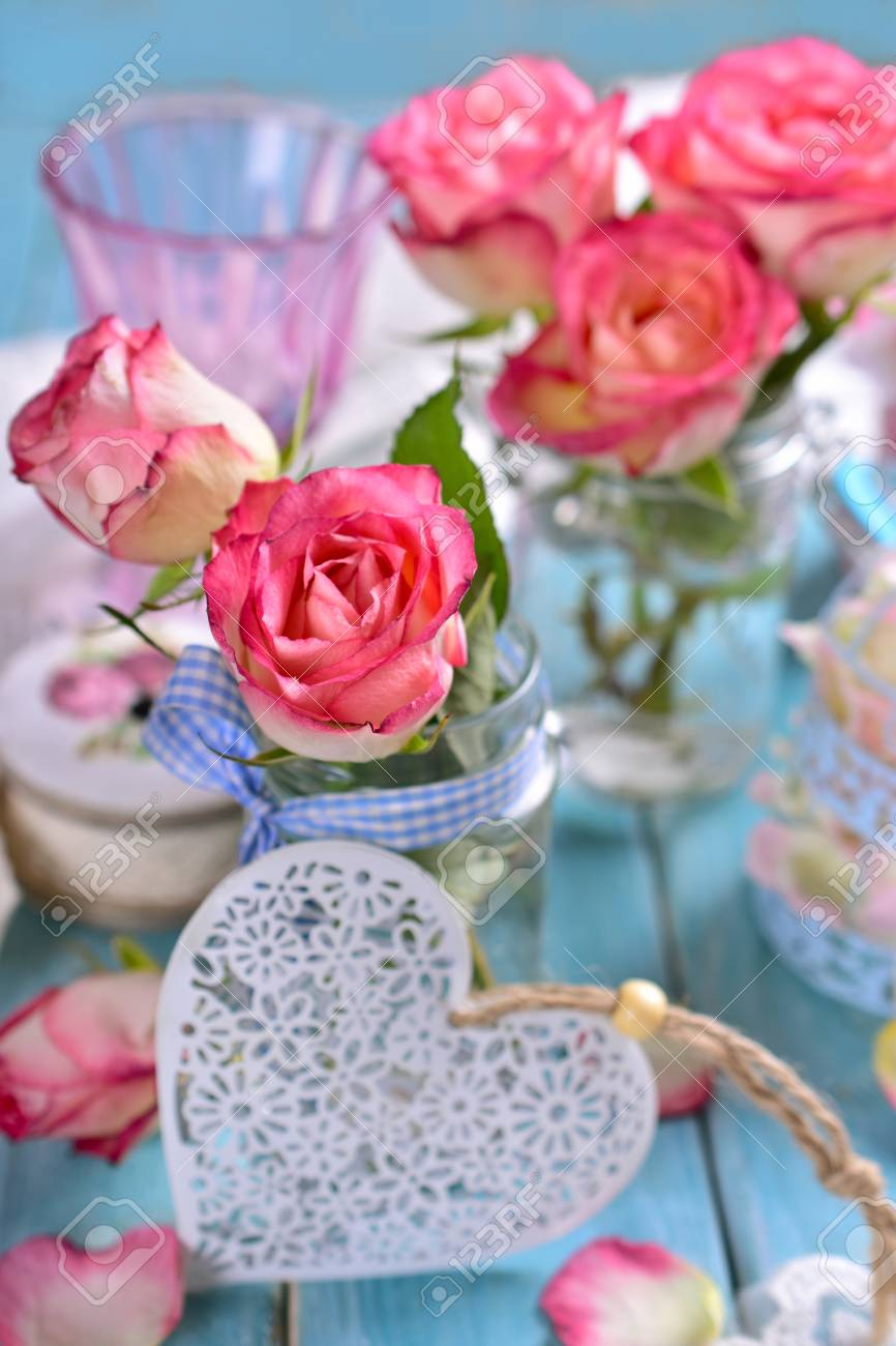Romantic Shabby Chic Blue Table Decoration With Fresh Pink Roses