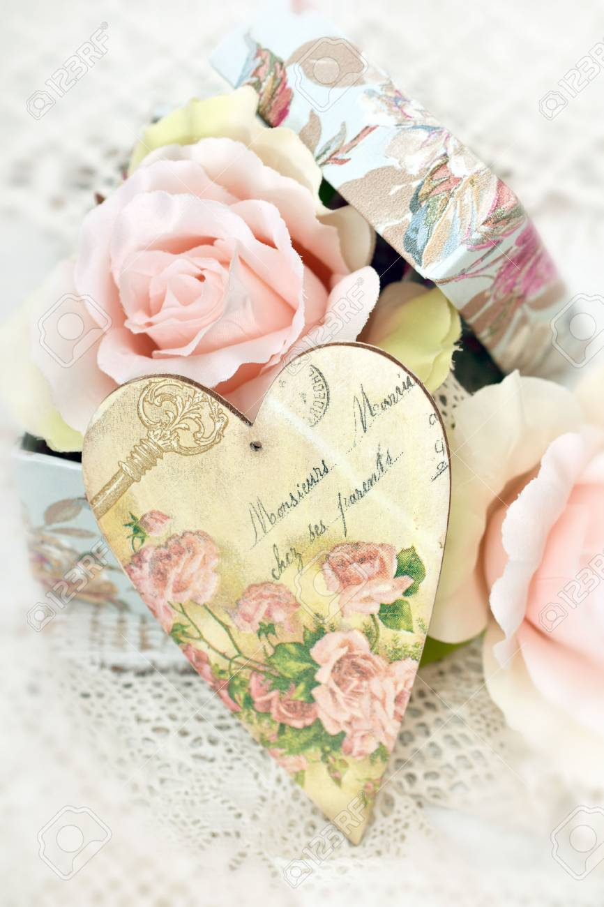 vintage style LOVE decoration with decoupage heart and roses..
