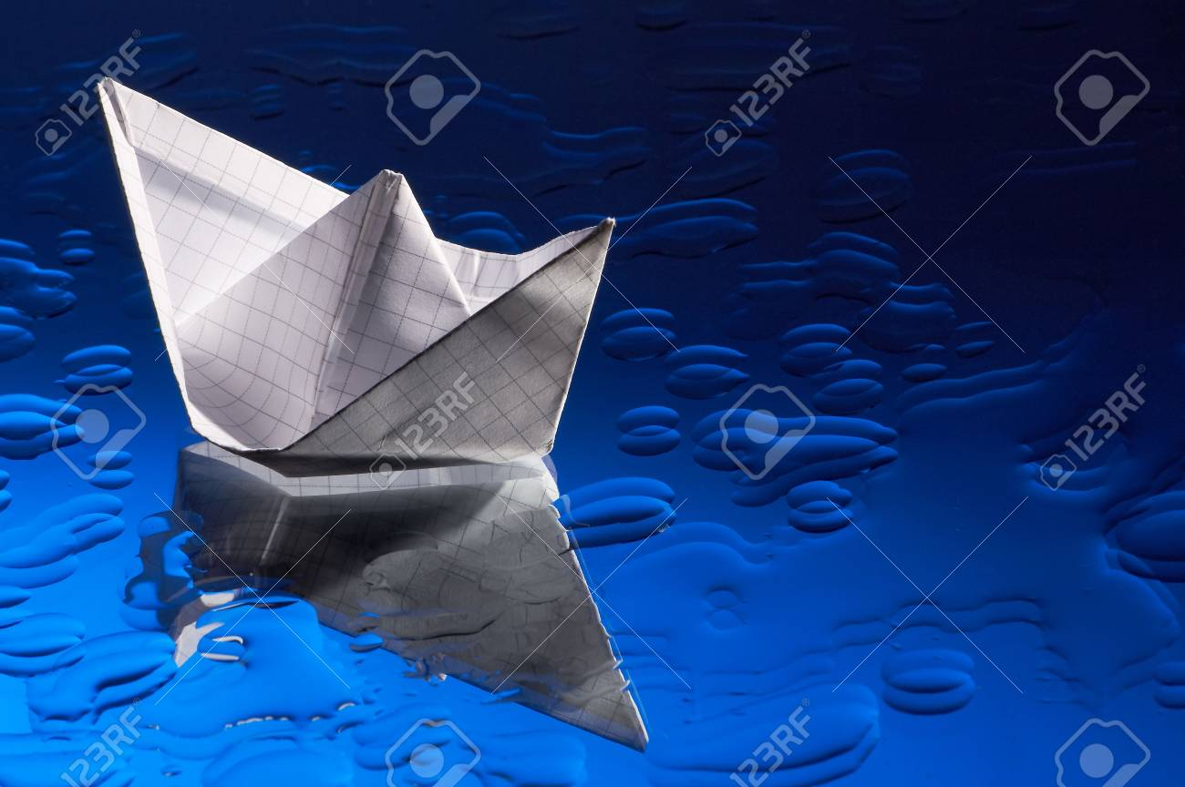 Paper ship and water on a mirror Stock Photo - 711764