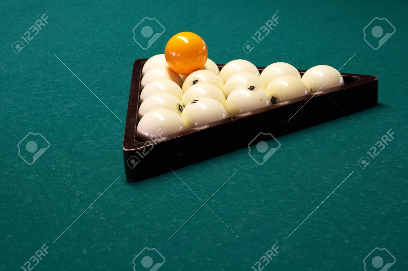 Billiard spheres in a triangle on a table Stock Photo - 759300