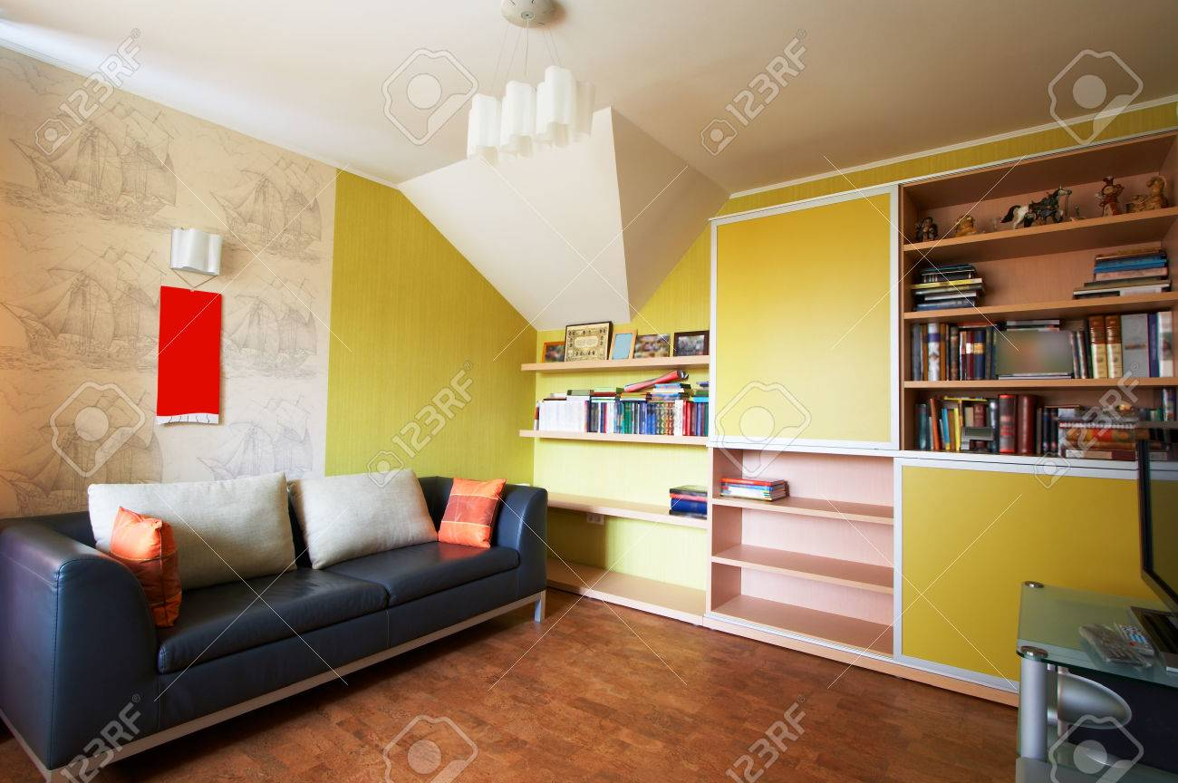 Sofa with pillows and a bookcase in an apartment Stock Photo - 1512052
