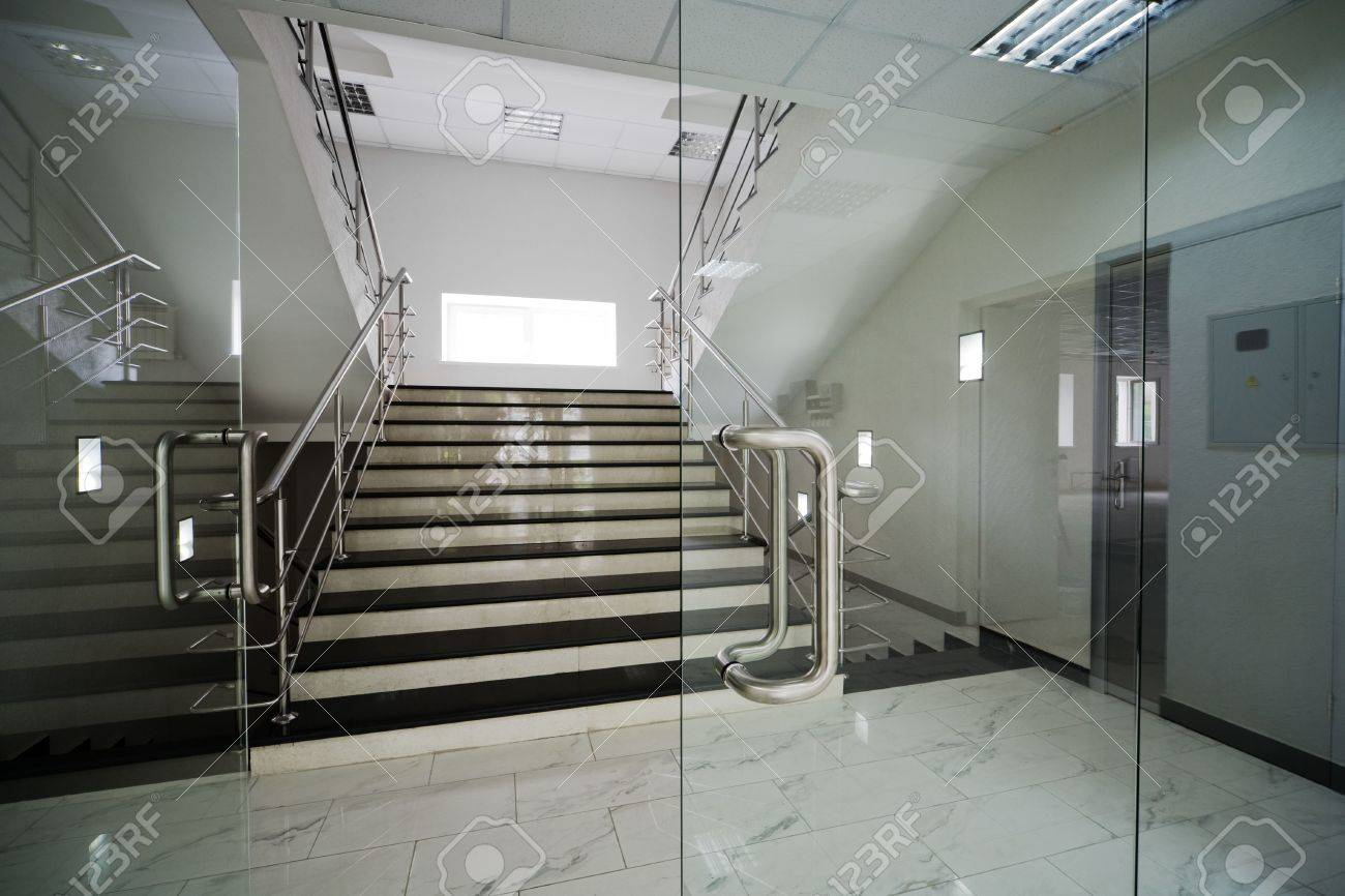 Glass Palace: Glass Doors With A Kind On A Marble Staircase