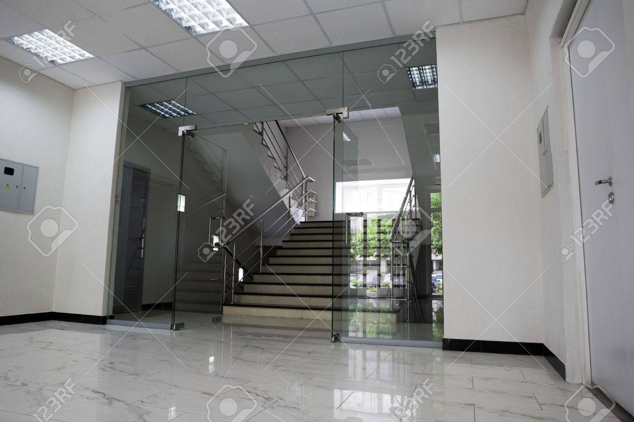 Glass doors with a kind on a marble staircase Stock Photo - 3098486