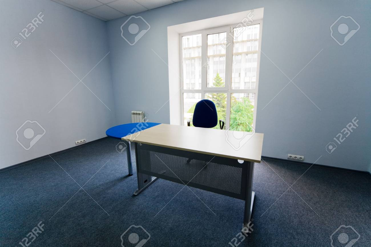 Chair and table at a window at modern office Stock Photo - 3142914