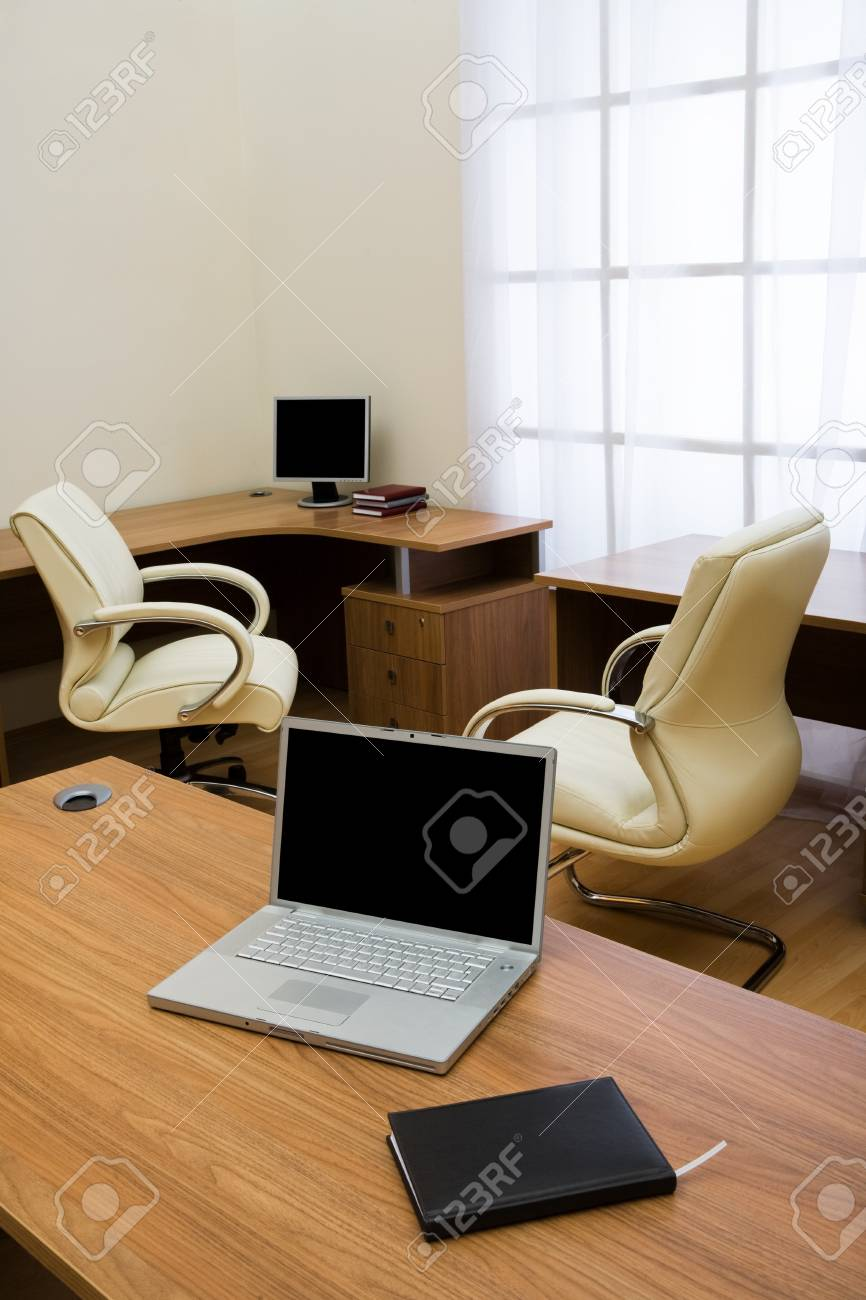 New laptop on a table at modern office Stock Photo - 4075188