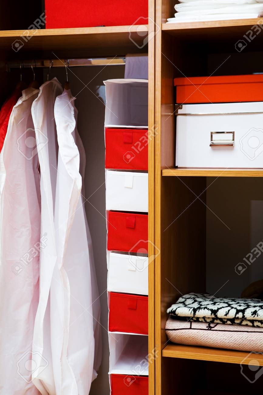 Clothes and towels in a wooden wardrobe Stock Photo - 4169857