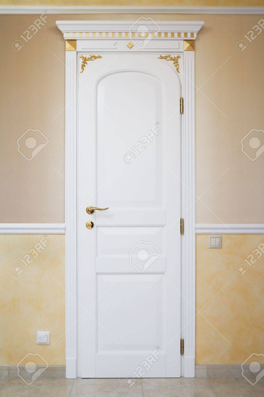 White door with an ornament in a modern apartment Stock Photo - 4328534