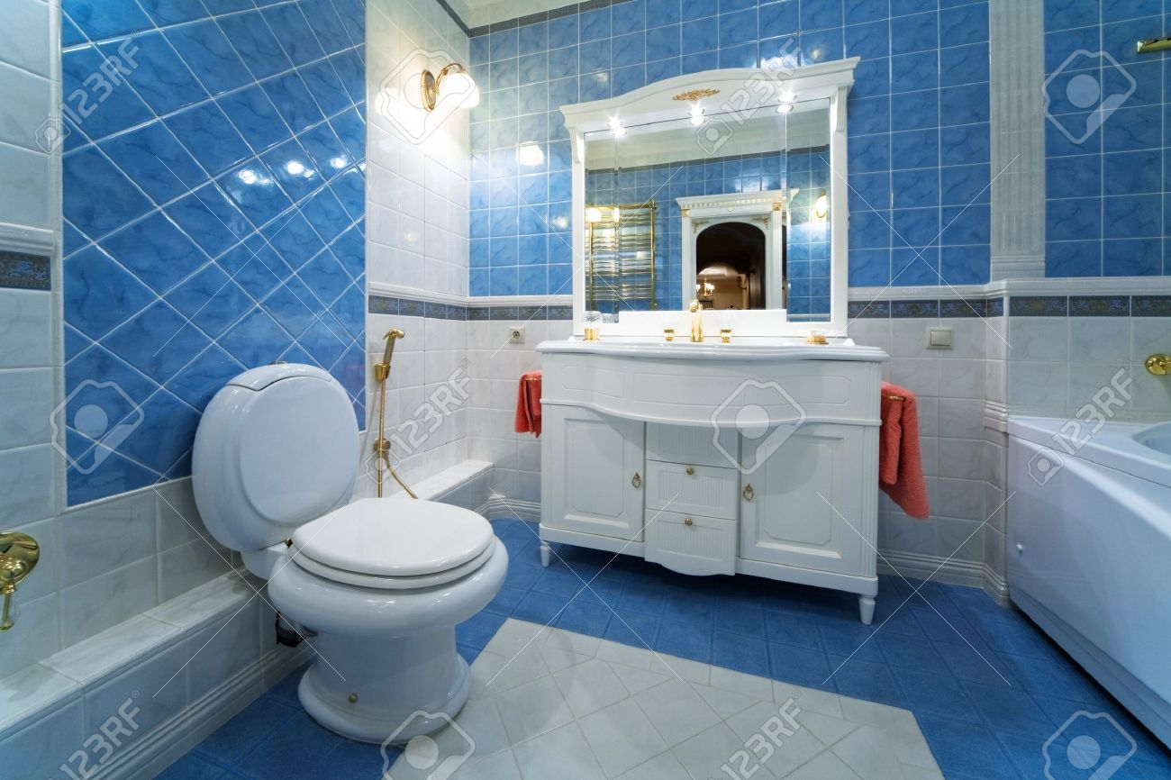 Fashionable Blue Bathroom In A Modern Apartment Stock Photo, Picture ...