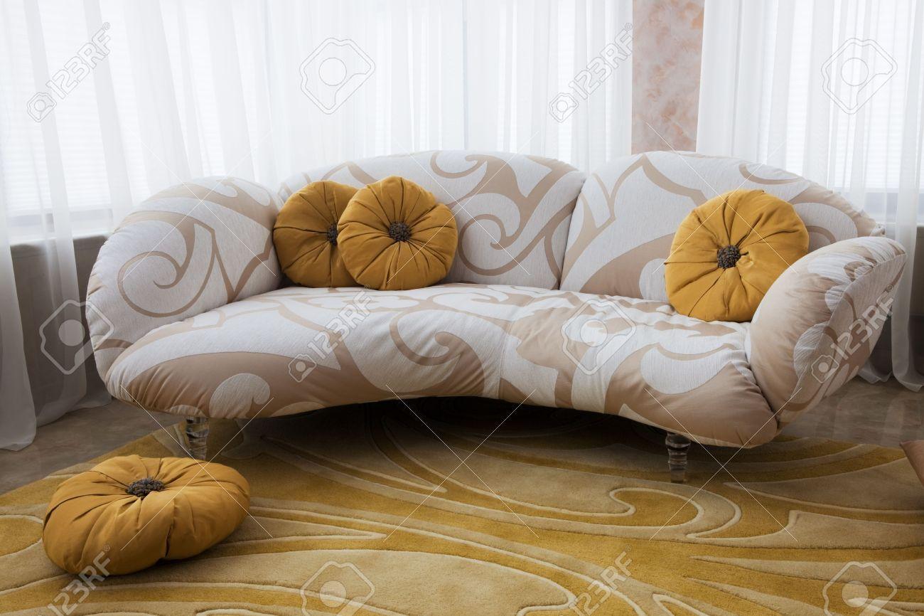 beautiful sofa near the window in the apartment stock photo