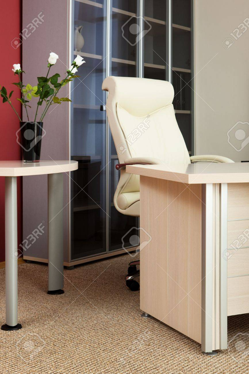 Leather armchair director in a modern office Stock Photo - 7731105