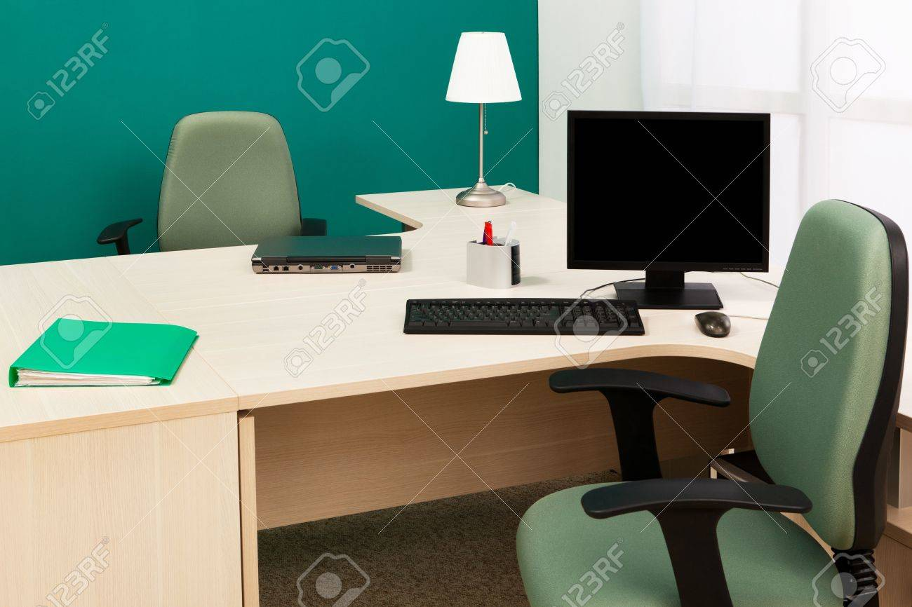 laptop and computer on a desk in a modern office Stock Photo - 8374509