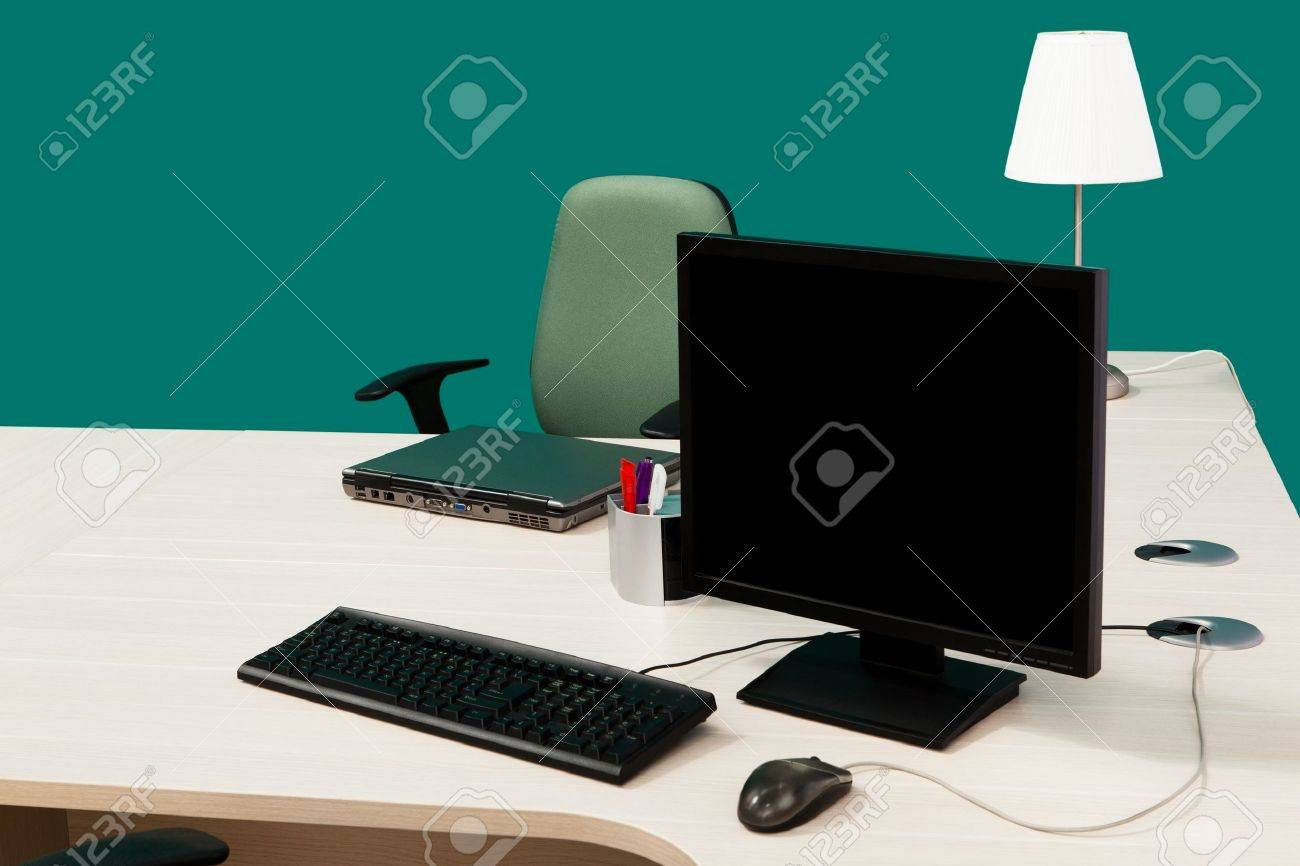 laptop and computer on a desk in a modern office Stock Photo - 8499182