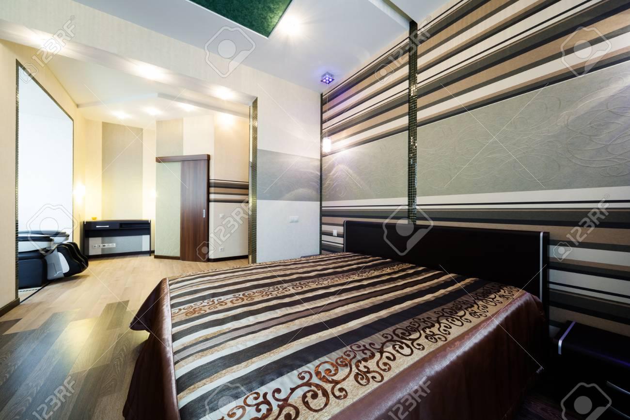 Beautiful wide bed in a modern bedroom