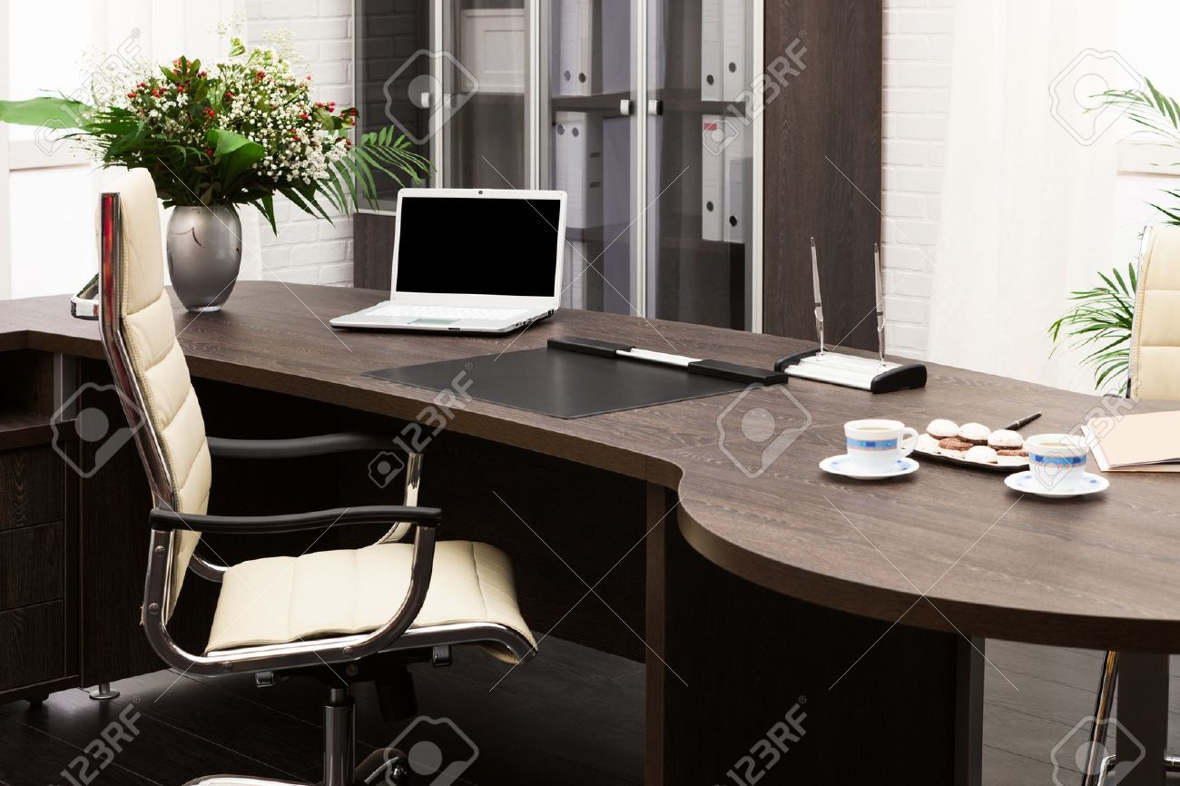 laptop and flowers on the table in a modern office Stock Photo - 18233301