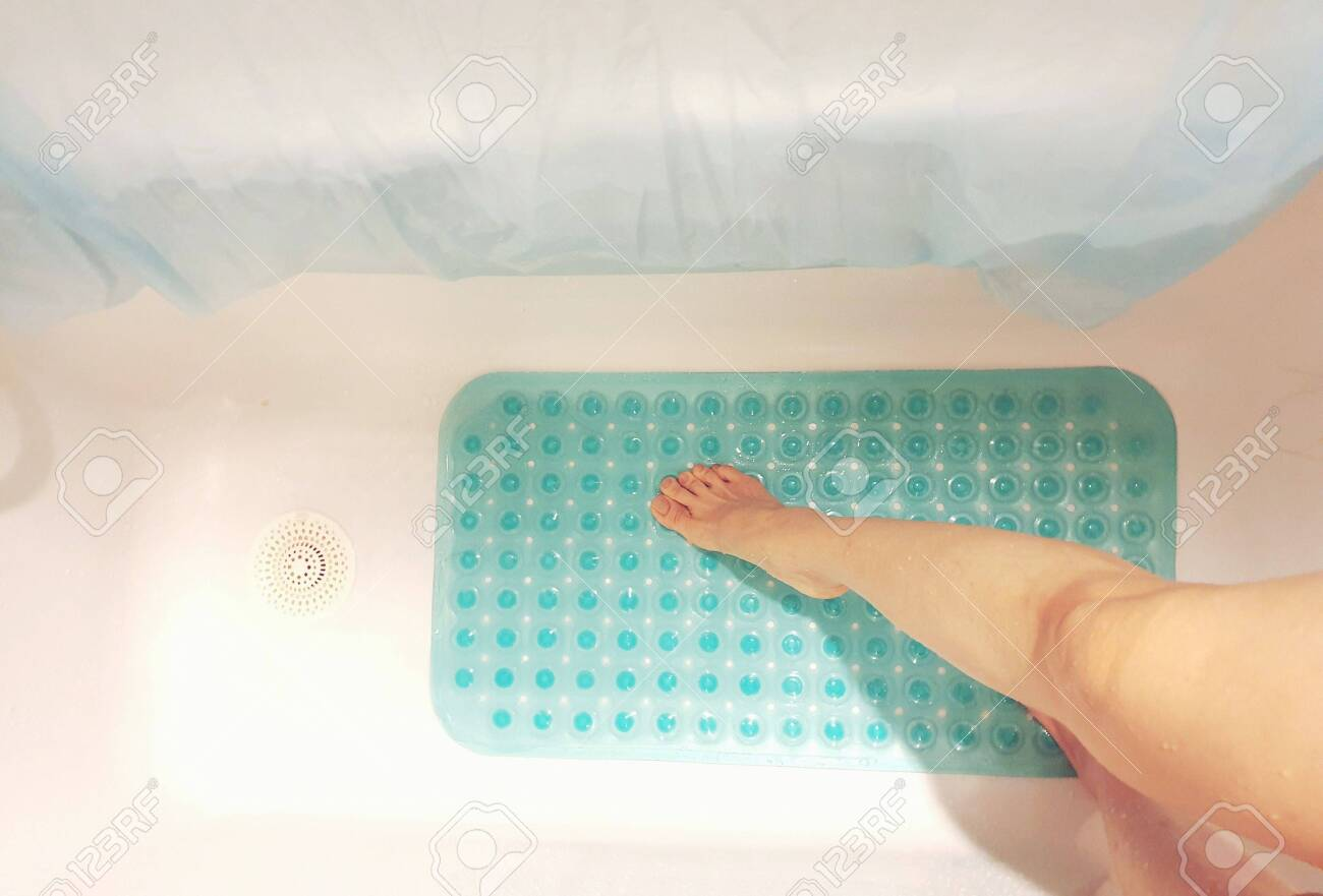 Conceptual image of taking safety precaution using an anti-slip in bathtub to prevent accidents - 132125019