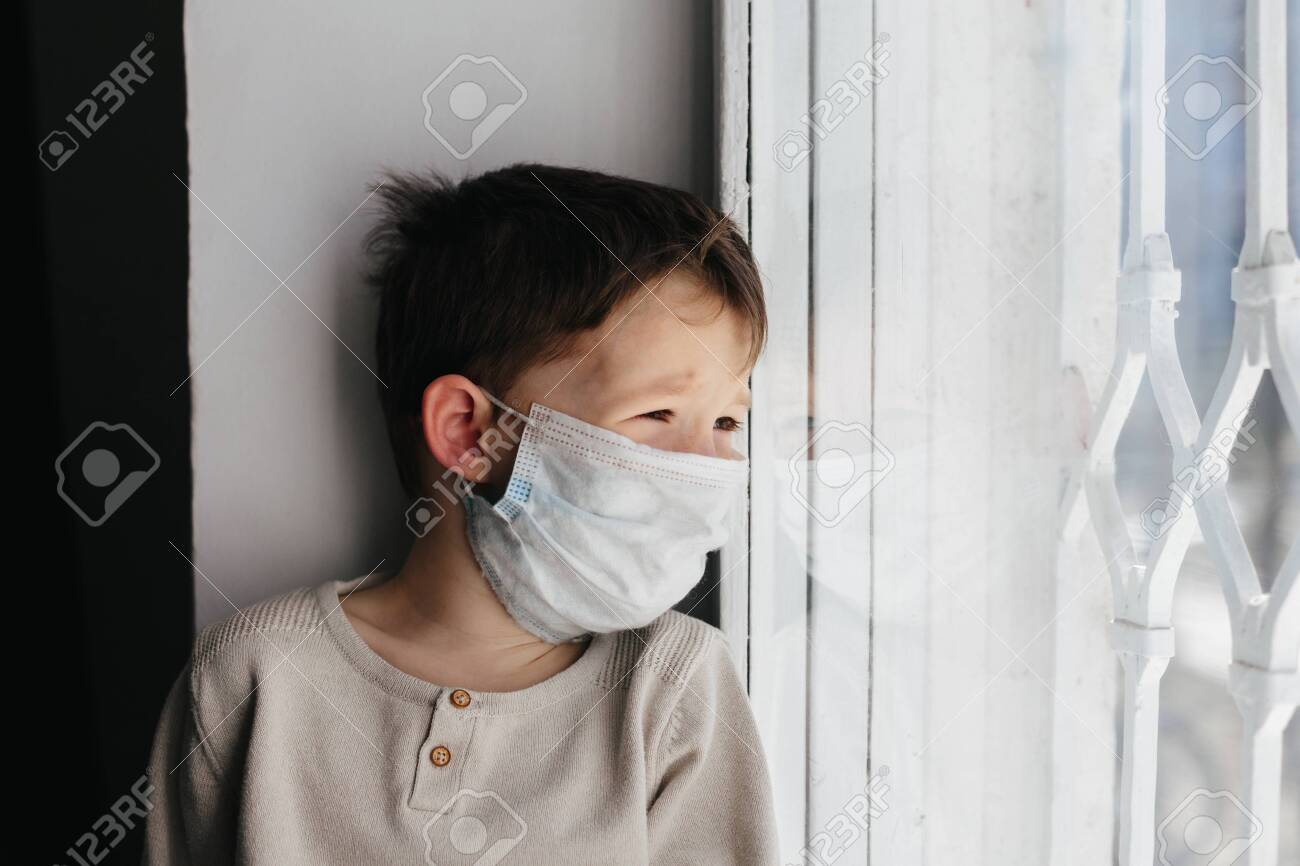 5 Years Boy Wearing Surgical Protection Face Mask Sitting At Stock Photo Picture And Royalty Free Image Image 143877111